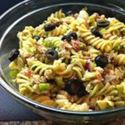 Tuna Souvlaki Pasta Salad - A dinner-style pasta salad tossed with tuna, feta cheese, roasted red peppers, and Greek vinaigrette dressing is perfect for weeknights or picnics.