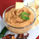 Spicy Hummus - Garbanzo beans, serrano chile peppers, and plenty of garlic are blended together in this spicy hummus recipe.