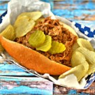 Simple Slow Cooker Pulled Pork - Succulent pulled pork slow cooked in a smokey homemade barbeque sauce makes perfect sandwiches for picnics, football Sundays, or dinner.