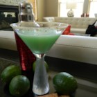 Key Lime Pie Martini - Vanilla-flavored vodka and triple sec mix with pineapple juice, sweetened lime juice, and a bit of cream to deliver a martini that tastes like Key lime pie.