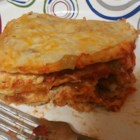 Easy Enchilada Casserole - No stuffing or rolling necessary to make these enchiladas. Just mix together shredded chicken with sour cream, jack cheese and soup, then layer with tortillas and salsa.