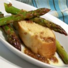 Grilled Asparagus with Roasted Garlic Toast and Balsamic Vinaigrette - Asparagus is grilled or sauteed with shallots, balsamic and red wine vinegars, and served with bread and roasted garlic.