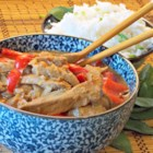 Slow Cooker Thai Pork with Peppers - Slow-cooked pork simmers in a Thai-inspired peanut sauce with red bell peppers until tender.
