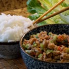 Asian Chicken and Rice Lettuce Wraps - Chicken, rice, water chestnuts, and crunchy veggies seasoned with Asian stir-fry sauce make quick and delicious lettuce wraps.
