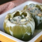 Chicken-Stuffed Peppers - These peppers stuffed with goat cheese, chicken, peppers, and onions are super easy to make, and even the kids will enjoy them!