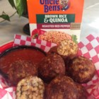 Jan's Brown Rice and Quinoa Cheesy Rice Balls - Cooked rice mixed with lots of cheese is rolled into balls, breaded, and pan fried in a delicious twist on fried mozzarella sticks.
