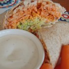 Buffalo or Barbeque Chicken and Rice Wraps - Shredded chicken, quick brown rice, shredded cheese, buffalo wing sauce (and more!) are wrapped in tortillas and served with baby carrots, celery sticks, and ranch dressing for dipping.