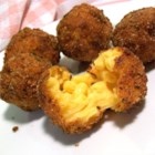 Fried Mac and Cheese Balls - Mac and cheese becomes fun finger food! This mac is cheesed to the max with Cheddar, Italian cheeses, and even pimento cheese spread; chilled, then scooped into balls, breaded, and fried.