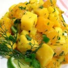 Summer Sweet Scorcher Salad - This refreshing combination of oranges, mango, yellow pepper, and chiles is brightened with fresh herbs and lime juice. Serve alone as a salad or with chips for dipping.