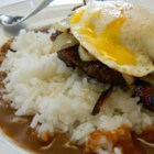 Mauigirl's Loco Moco - Serve a taste of Hawaiian loco moco for breakfast - rice topped with a burger patty and fried onions, and brown gravy is topped with a fried egg.