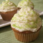 Coconut Cupcakes - Traditional white cupcake batter gets a tropical twist with the addition of coconut milk and shredded coconut to the batter creating rich and moist coconut cupcakes.