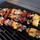 Orange Chicken Kabobs - Chicken is marinated in an orange marmalade marinade and grilled on skewers with vegetables and pineapple in this summery orange chicken kabob recipe.