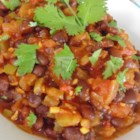 Spicy Vegetarian Black Beans (Fusion) - This vegetarian spicy black bean recipe hits a home run with cilantro, garlic, turmeric, cumin, serrano peppers and lime juice.