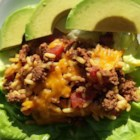 Taco Rice Bake - Taco-seasoned ground beef, flavored rice, and lots of cheese can be served with a variety of toppings in a number of ways - in taco shells, lettuce wraps, or just as is.