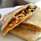 Wild Rice, Corn, and Black Bean Quesadillas - These quick and delicious quesadillas are filled with rice, corn, black beans, and cheese and served with your favorite salsa.