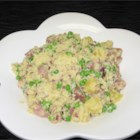 Ham and Pineapple Couscous Salad - Toss buttered and seasoned couscous with cubes of ham, pineapple chunks, sweet red onions and green peas. Serve with a tangy dressing of pineapple juice and Dijon-style mustard for a light, refreshing salad.