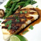 Halibut with Rice Wine - Grilled halibut is served with a delicious Asian-style sauce featuring shallots, sesame oil, soy sauce, and rice wine.