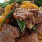 Quick Orange Pork Stir Fry - Teriyaki pork tenderloin, mandarin oranges, and sugar snap peas make up this recipe for a delicious weeknight orange pork stir fry.
