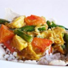 Jasmine Rice and Red Curry Chicken Wonton Bowls - Crispy wonton bowls are filled with jasmine and topped with chicken and veggies smothered in a red curry sauce for a fragrant Thai-inspired meal.