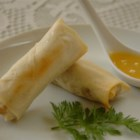 Baked Pork Spring Rolls - An exciting blend of pork, vegetables and spices is sealed inside wrappers, then baked until crisp. Delicious and crunchy without deep frying!