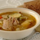 White Wine Chicken Soup - Chicken and a multitude of vegetables, including a whole head of garlic, and a touch of white wine are simmered a good long while for a mellow flavor.