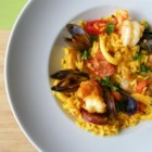 Paella I - A very traditional paella, garnished with chorizo, chicken, peas, squid, mussels, and shrimp. Spanish Chorizo is a smoked sausage with a different flavor than Mexican chorizo. A paella pan is recommended for this recipe.