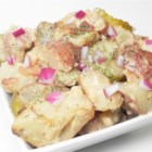 Grilled Potato Salad with Crazy Steve's Cajun Cukes - Grilled potato salad, made with grilled potatoes, bacon, and onion, is tossed in a mayonnaise-pickle-based dressing for the ultimate side dish at the barbeque.