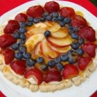 Easy Summer Pie -   This pretty pie will bring lots of compliments. A simple, sweetened cream cheese filling is spread over a freshly-baked pie crust and topped with mounds of sliced fruit: raspberries, blueberries, mandarin oranges, strawberries and kiwi.