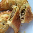 Argentinian Beef Empanadas - Beef, raisins, and olives make a flavorful mix inside a toasty pocket of bread for easy transportation and even easier eating.