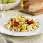 Barilla(R) Macaroni Pasta Salad with Cherry Tomatoes, Fresh Mozzarella and Basil - Take along a lovely cool pasta salad of Barilla(R) Macaroni pasta, halved cherry tomatoes, fresh mozzarella, and fresh basil.