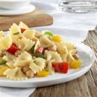 Barilla(R) Farfalle with Sweet Bell Peppers, Chickpeas and Romano Cheese. - Colourful sweet bell peppers combine with Barilla(R) Farfalle pasta, chickpeas, fragrant oregano, and Romano cheese in this rustic dish.