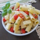 Caprese Pasta Salad - The dynamic trio of fresh basil pesto, mozzarella cheese, and juicy tomato are reunited once again in an American favorite--the pasta salad.