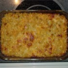 Lisa's Macaroni and Cheese - This warm, gooey casserole is an happy merger of macaroni, butter, milk, dashes of onion and garlic powders, a sprinkling of parsley flakes and three kinds of full-flavored cheeses. Just toss them all together and bake until perfectly melted.