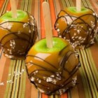 Sweet and Salty Caramel Apples - Sweet, salty and chocolaty are a great combination to have with Granny Smith Apples. Try these treats at your next Fall gathering.