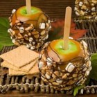 S'mores Apples - Caramel apples are studded with graham crackers and marshmallows and drizzled with chocolate for a treat you can't get enough of.