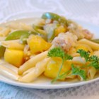 Chicken and Pasta in a Mango Cream Sauce - This creamy, cheesy pasta dish is very rich and has a subtle, fruity flavour. It was an experiment that turned out to be delicious. Enjoy.