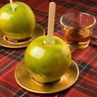 Bourbon Candy Apples - Bourbon adds a rich flavor to these hand dipped caramel apples.
