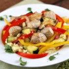 Southwestern Pork Stir Fry - Chunks of smoky pork loin filet are stir fried with lots of fresh veggies in a savory broth. Serve over polenta or rice.