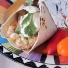 Posolequeso Burrito - All the flavors of Mexican posole, including pulled pork and hominy, are topped with Cheddar cheese in this recipe for on-the-go burritos.