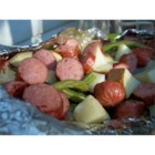Grilled Sausage with Potatoes and Green Beans - Sausage and vegetables are grilled together in a foil packet. This recipe is easy and delicious, and perfect for a quick holiday meal or camping!