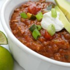 Terrific Turkey Chili - This quick turkey chili recipe using zucchini, green onion, sour cream, and cheddar cheese will please even the pickiest eater.