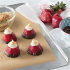 Strawberry Cheesecake Bites - A lightly sweet vanilla cream cheese filling is piped into the center of large fresh strawberries in this fun but elegant dessert. Dipping the berries in chocolate is an optional extra.