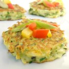 Low Carb Zucchini Pancakes - Freshly grated zucchini is mixed with fresh herbs and spices for a flavorful and simple pancake. Serve with sour cream, salsa, or cream cheese!