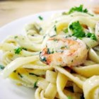 Cajun Seafood Pasta - Three kinds of pepper turn up the heat in this creamy shrimp and scallop sauce. Fresh basil, thyme and parsley add just the right counterpoint, while Swiss and Parmesan cheese add their own sharp flavors. Perfect over fettucine!