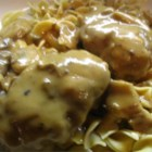 Scrumptious Salisbury Steak in Mushroom Gravy - A classic Salisbury steak in beef and mushroom gravy. This simple, hearty dish will remind you of Sunday dinners at grandma's house.  This is my husband's all-time favorite meal. The recipe makes plenty of gravy, so serve with mashed potatoes or buttered noodles.