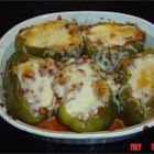 Stuffed Green Peppers II - Green bell peppers stuffed with ground beef, onion and rice, and then baked and topped with spaghetti sauce.
