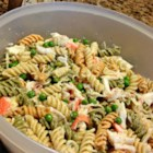 Paul Newman Crab Salad - This pasta salad with imitation crab, peas, and cheese is dressed with a simple vinaigrette for a delightful potluck or picnic dish.