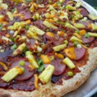 BBQ Pizza - Hawaiian Style - Pizza made with barbeque sauce, pineapple, ham, and Cheddar cheese is a unique, Hawaiian-style bbq pizza that is quick and easy to prepare.