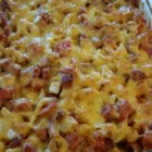 Cheesy Smoked Sausage Casserole - Just like grandma used to make, this smoked sausage casserole recipe features Cheddar, Monterey Jack, and American cheese.