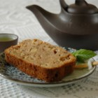 Spiced Applesauce Bread - Something like a dense version of applesauce spice cake, this moist, quick nut bread is fragrant with apple, cinnamon, nutmeg and allspice.